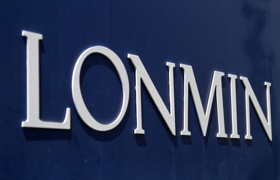 Lonmin full-year loss widens on impairment charge